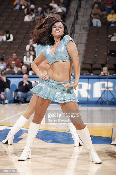 Denver Nuggets dancers perform oncourt during a break in NBA game action against the Golden State Warriors on February 12 2007 at the Pepsi Center in...