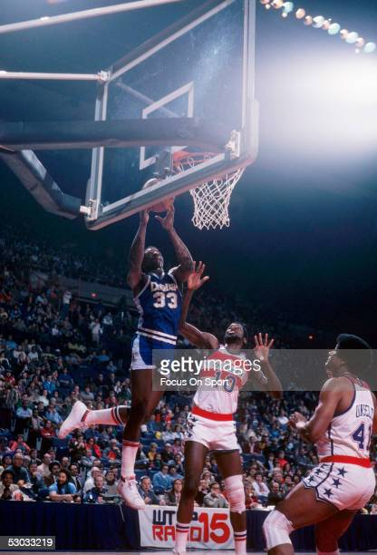 Denver Nuggets' David Thompson jumps for a layup during a game against the Washington Bullets at Capital Centre circa 1978 in Washington DC NOTE TO...