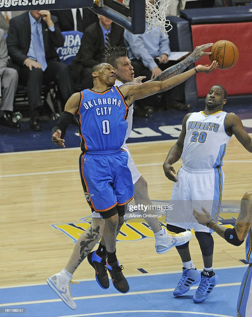 Denver Nuggets forward Chris Andersen, right, and the Oklahoma City Thunder's Russell Westbrook fight for a rebound during the fourth quarter of play in game 3 of the first round of the 2011 NBA Playoffs Saturday April 23, 2011 at the Pepsi Center. Photo  : News Photo