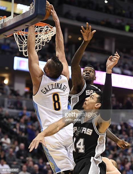 Denver Nuggets forward Danilo Gallinari gets a big dunk on San Antonio Spurs center Dewayne Dedmon and San Antonio Spurs guard Danny Green during the...