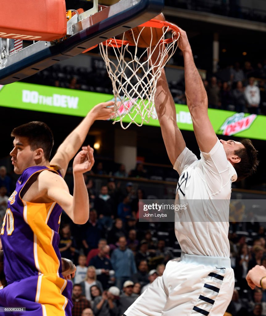 Denver Nuggets forward Danilo Gallinari (8) gets a dunk on Los Angeles Lakers center Ivica Zubac (40) during the first quarter on March 13, 2017 in Denver, Colorado at Pepsi Center.
