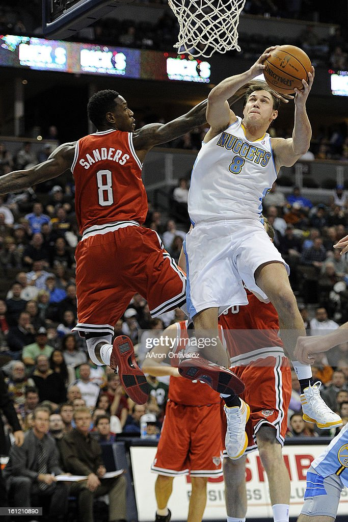 Denver Nuggets forward Danilo Gallinari (8) is fouled by Milwaukee Bucks power forward Larry Sanders (8) during the second quarter at the Pepsi Center on Monday, January 2, 2012. AAron Ontiveroz, The Denver Post : News Photo