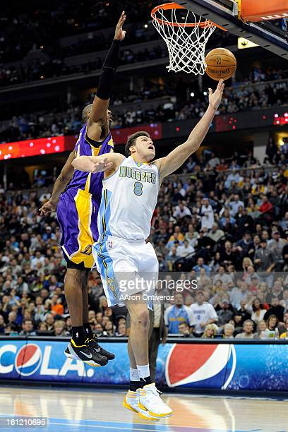 Denver Nuggets forward Danilo Gallinari makes a layup under the outstretched arm of Los Angeles Lakers shooting guard Kobe Bryant during the second...