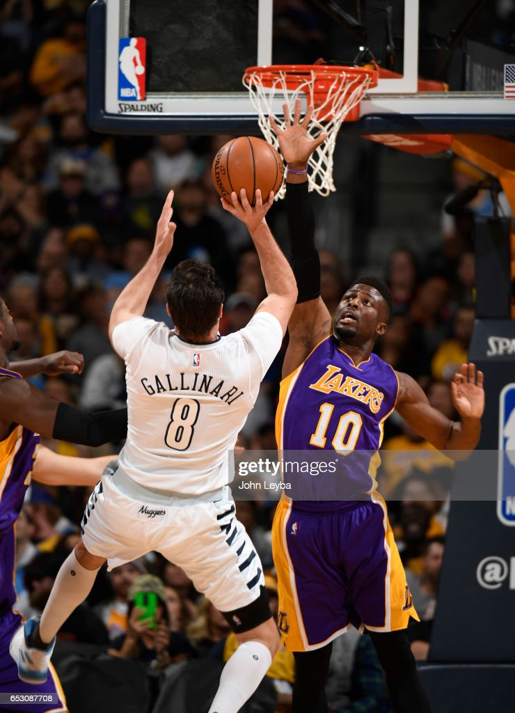 Denver Nuggets forward Danilo Gallinari (8) takes an off balance shot over Los Angeles Lakers guard David Nwaba (10) during gate third quarter on March 13, 2017 in Denver, Colorado at Pepsi Center. Gallinari was fouled on the play.