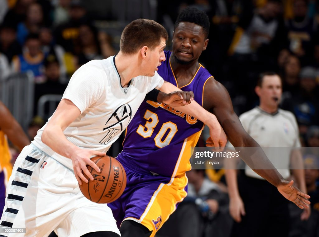 Denver Nuggets forward Nikola Jokic (15) gets pressure from Los Angeles Lakers forward Julius Randle (30) during the third quarter on March 13, 2017 in Denver, Colorado at Pepsi Center.