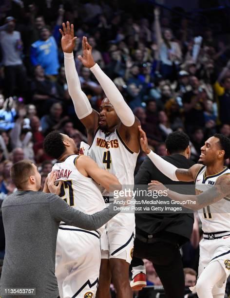 Denver Nuggets forward Paul Millsap celebrates a three point basket with teammates Denver Nuggets forward Juan Hernangomez Denver Nuggets guard Jamal...
