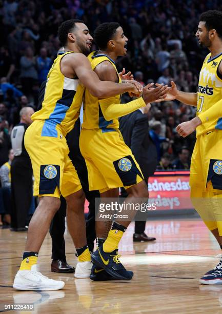 Denver Nuggets forward Trey Lyles left guard Gary Harris center and Jamal Murray celebrate their victory over the Dallas Mavericks 9189 at the Pepsi...