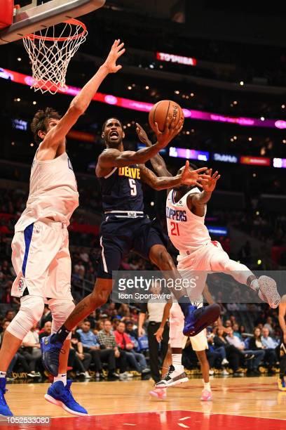 Denver Nuggets Forward Will Barton shoots a layup over Los Angeles Clippers Center Boban Marjanovic during an NBA preseason game between the Denver...