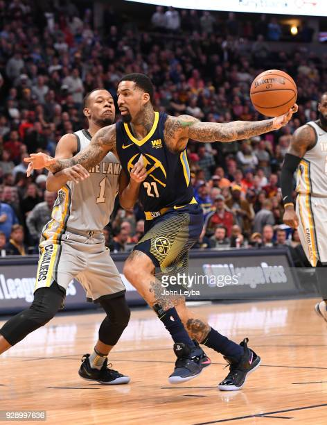Denver Nuggets forward Wilson Chandler drives on Cleveland Cavaliers guard Rodney Hood in the first quarter on March 7 2018 at Pepsi Center