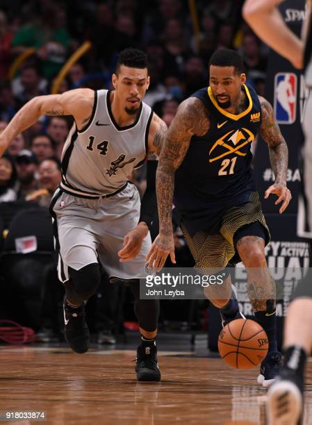 Denver Nuggets forward Wilson Chandler pushes the ball up court as San Antonio Spurs guard Danny Green follows him during the third quarter on...