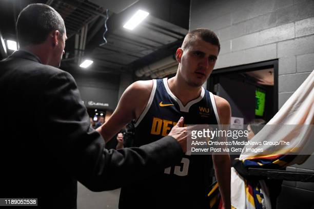 Denver Nuggets general manager Arturas Karnisovas pats star Nikola Jokic after he led his team against the Houston Rockets in a 10595 win on...