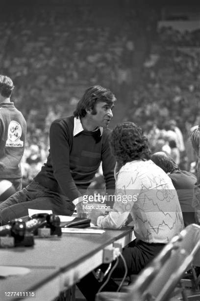 Denver Nuggets general manager Carl Scheer sits on the scorer's table during a game against the New York Nets at McNichols Arena on December 8 1975...