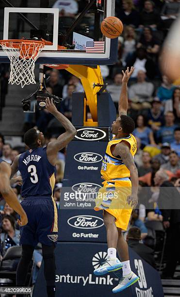 Denver Nuggets guard Aaron Brooks hits a shot high off the glass for two of his first half 15 points as New Orleans Pelicans guard Anthony Morrow...