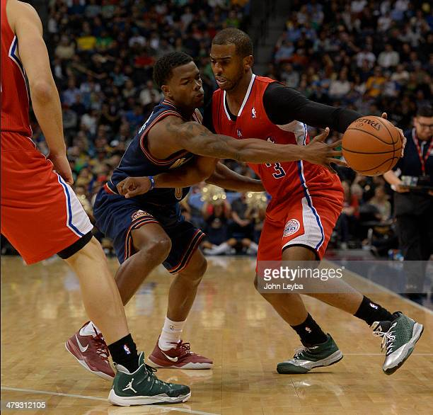 Denver Nuggets guard Aaron Brooks reaches in on Los Angeles Clippers guard Chris Paul during the third quarter March 17 2014 at Pepsi Center