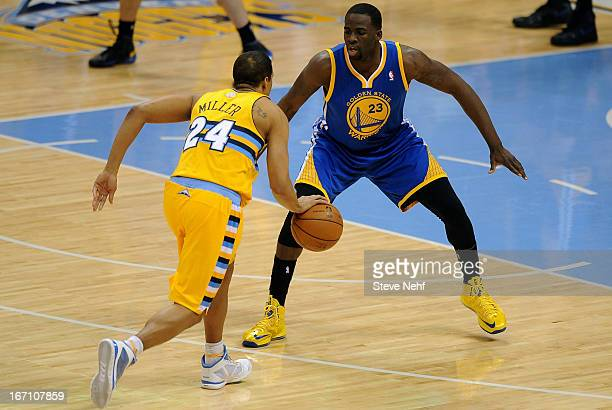 Denver Nuggets guard Andre Miller drives against Draymond Green for the winning basket in the fourth quarter The Denver Nuggets defeated the Golden...