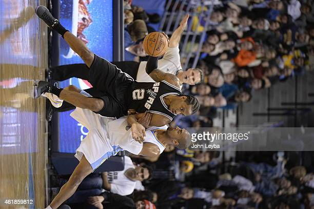 Denver Nuggets guard Arron Afflalo puts pressure on San Antonio Spurs forward Kawhi Leonard during the third quarter January 20 2015 at Pepsi Center
