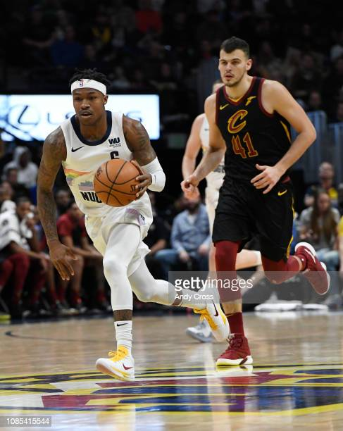 Denver Nuggets guard Brandon Goodwin takes the ball down court against Cleveland Cavaliers center Ante Zizic in the second half at the Pepsi Center...
