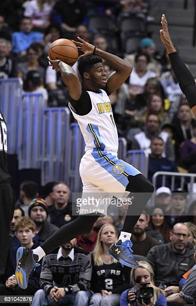 Denver Nuggets guard Emmanuel Mudiay makes a leaping pass during the first quarter against the San Antonio Spurs January 5 2016 at Pepsi Center