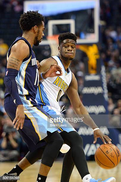 Denver Nuggets guard Emmanuel Mudiay tries to back down Memphis Grizzlies guard Mike Conley during the first quarter at the Pepsi Center on January...