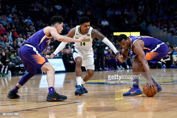 Denver Nuggets guard Gary Harris #14 loses the ball during the first half of an NBA game at Pepsi Center on January 3 2018 in Denver Colorado The...