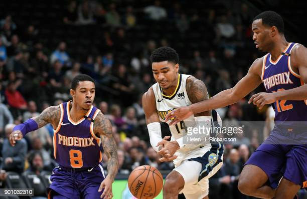 Denver Nuggets guard Gary Harris #14 loses the ball to Phoenix Suns' guards Tyler Ulis #8 left and TJ Warren #12 right during the first half of an...