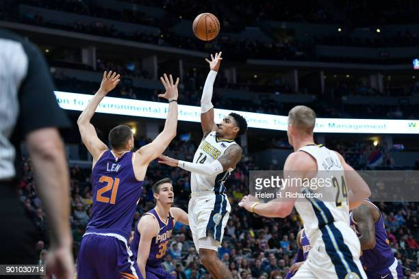 Denver Nuggets guard Gary Harris #14 takes a shot at the basket during the first half of NBA game at Pepsi Center on January 3 2018 in Denver...