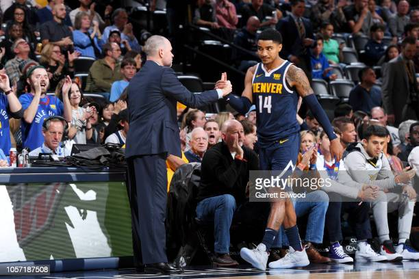 Denver Nuggets guard Gary Harris and head coach Mike Malone of the Denver Nuggets shake hands during the game against the Utah Jazz on November 3,...