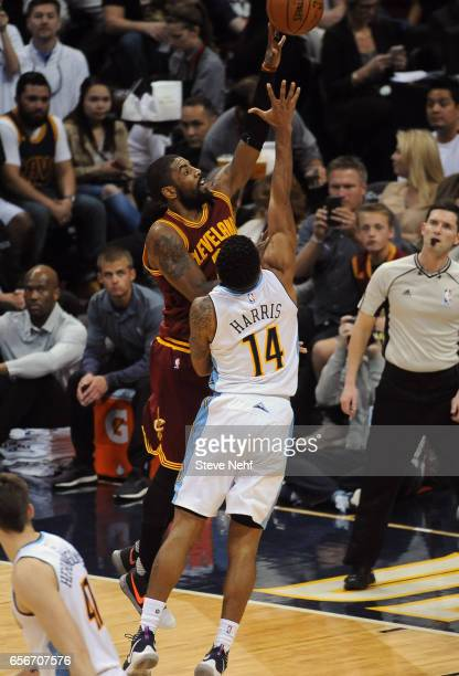 Denver Nuggets guard Gary Harris defends Kyrie Irving of the Cleveland Cavaliers in the first half at the Pepsi Center March 22 2017