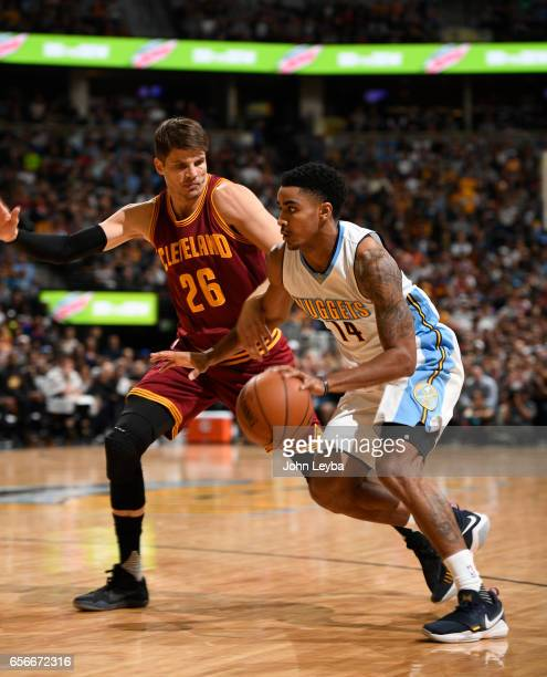 Denver Nuggets guard Gary Harris drives on Cleveland Cavaliers guard Kyle Korver during the first quarter on March 22 2017 in Denver Colorado at...