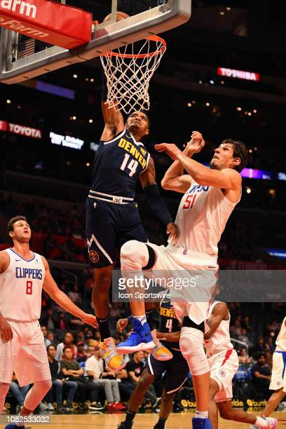 Denver Nuggets Guard Gary Harris dunks on Los Angeles Clippers Center Boban Marjanovic during an NBA preseason game between the Denver Nuggets and...
