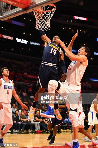 Denver Nuggets Guard Gary Harris dunks over Los Angeles Clippers Center Boban Marjanovic during an NBA preseason game between the Denver Nuggets and...