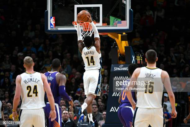 Denver Nuggets guard Gary Harris dunks the ball during the first half of an NBA game against the Phoenix Suns at Pepsi Center on January 3 2018 in...