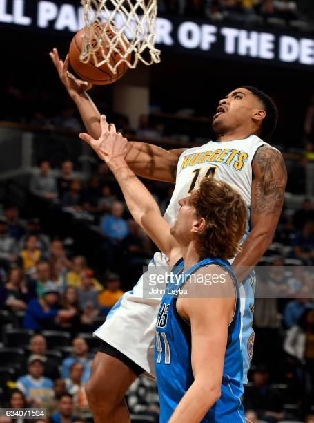 Denver Nuggets guard Gary Harris gets fouled by Dallas Mavericks forward Dirk Nowitzki during the first quarter February 6 2017 at Pepsi Center