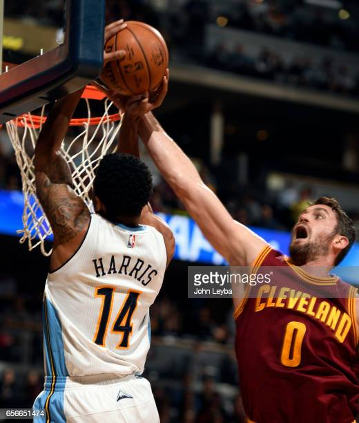 Denver Nuggets guard Gary Harris gets his shot blocked by Cleveland Cavaliers forward Kevin Love during the first quarter on March 22 2017 in Denver...