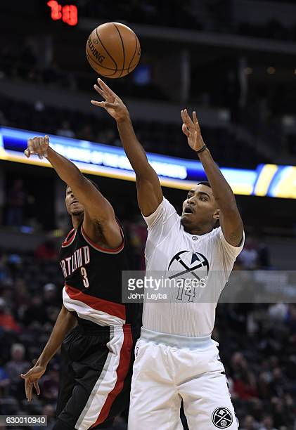 Denver Nuggets guard Gary Harris gets his shot blocked by Portland Trail Blazers guard CJ McCollum during the first quarter December 15 2016 at Pepsi...