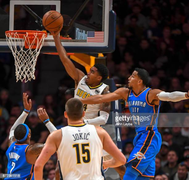 Denver Nuggets guard Gary Harris goes up for a bucket past Oklahoma City Thunder guard Andre Roberson during the third quarter on November 9, 2017 in...