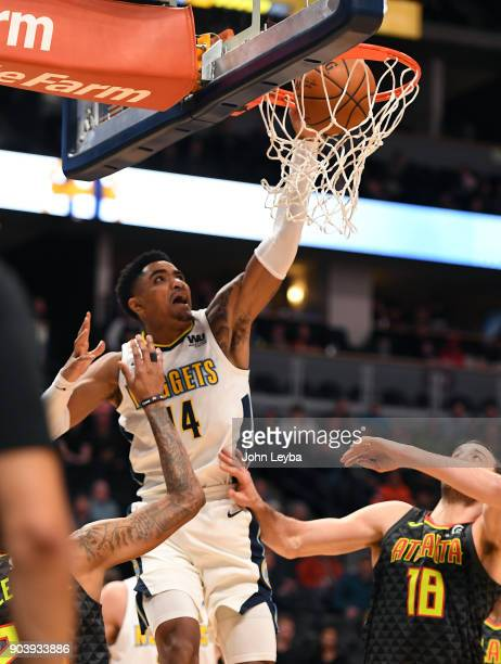 Denver Nuggets guard Gary Harris goes up for a dunk on Atlanta Hawks center Miles Plumlee during the third quarter on January 10 2018 at Pepsi Center