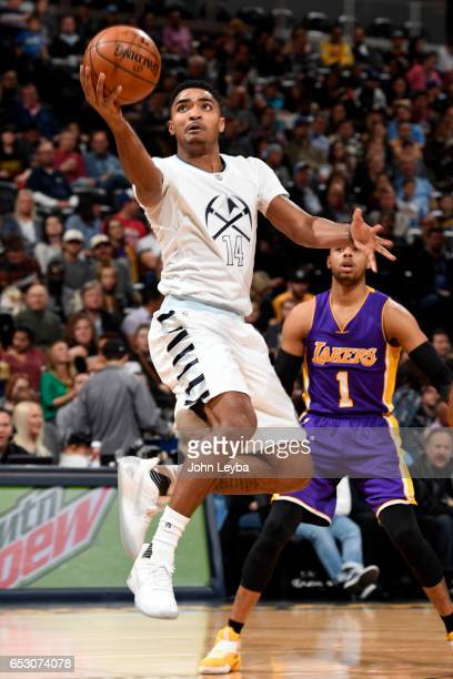 Denver Nuggets guard Gary Harris goes up for a layup against the Los Angeles Lakers during the second quarter on March 13 2017 in Denver Colorado at...