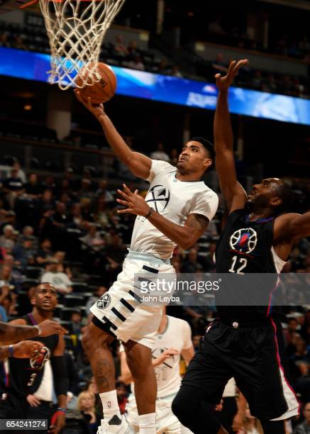 Denver Nuggets guard Gary Harris goes up for a layup on LA Clippers forward Luc Mbah a Moute during the first quarter on March 16 2017 in Denver...