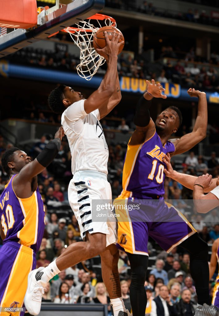 Denver Nuggets guard Gary Harris (14) goes up for a shot as Los Angeles Lakers guard David Nwaba (10) comes in on defense during the first quarter on March 13, 2017 in Denver, Colorado at Pepsi Center.