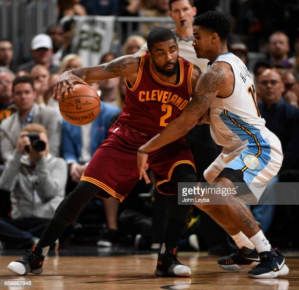 Denver Nuggets guard Gary Harris guards Cleveland Cavaliers guard Kyrie Irving during the second quarter on March 22 2017 in Denver Colorado at Pepsi...