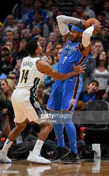 Denver Nuggets guard Gary Harris guards Oklahoma City Thunder forward Carmelo Anthony during the first quarter on November 9 2017 in Denver Colorado...
