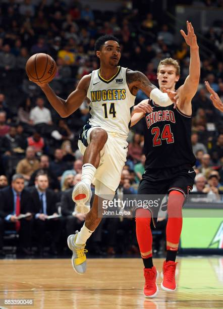 Denver Nuggets guard Gary Harris looks to pass the ball on Chicago Bulls forward Lauri Markkanen during the first quarter against the Chicago Bulls...