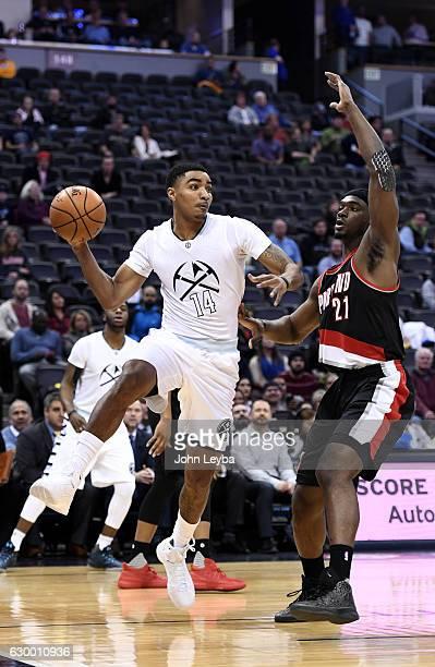Denver Nuggets guard Gary Harris makes a pass on Portland Trail Blazers forward Noah Vonleh during the first quarter December 15 2016 at Pepsi Center