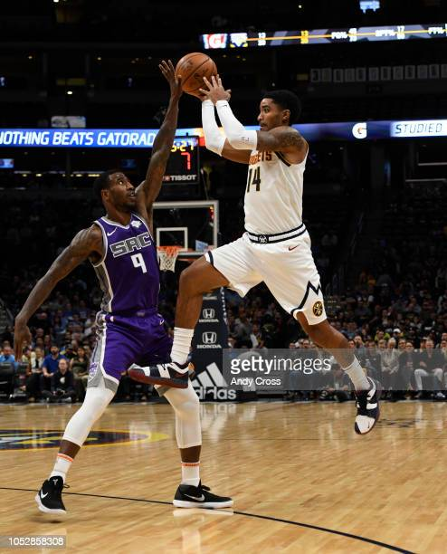 Denver Nuggets guard Gary Harris passes the ball off against pressure from Sacramento Kings guard Iman Shumpert in the first quarter at the Pepsi...