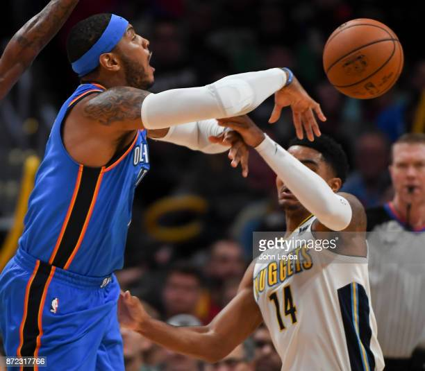 Denver Nuggets guard Gary Harris slaps the ball away from Oklahoma City Thunder forward Carmelo Anthony during the first quarter on November 9 2017...