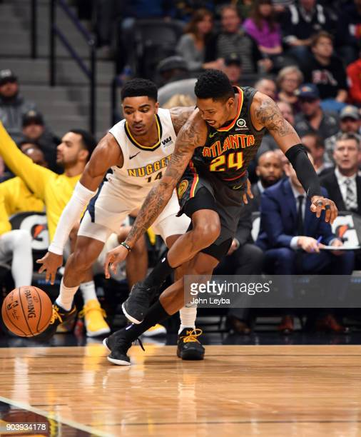 Denver Nuggets guard Gary Harris steals the ball away from Atlanta Hawks guard Kent Bazemore during the first quarter on January 10 2018 at Pepsi...
