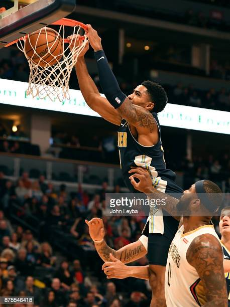 Denver Nuggets guard Gary Harris throws down a dunk past New Orleans Pelicans center DeMarcus Cousins during the first quarter on November 17 2017 in...
