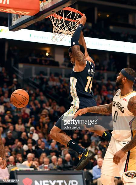 Denver Nuggets guard Gary Harris throws down a dunk past New Orleans Pelicans center DeMarcus Cousins during the first quarter on November 17, 2017...