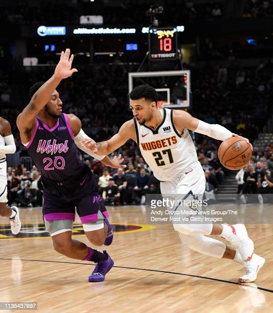 Denver Nuggets guard Jamal Murray drives against Minnesota Timberwolves guard Josh Okogie in the first half at Pepsi Center March 12 2019
